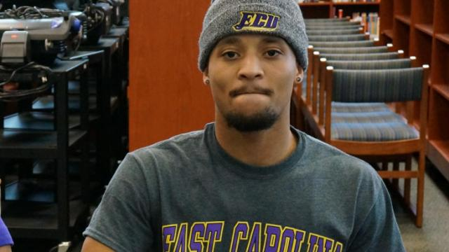 Knightdale receiver Marquavious Johnson signed his letter of intent to play for East Carolina Wednesday.