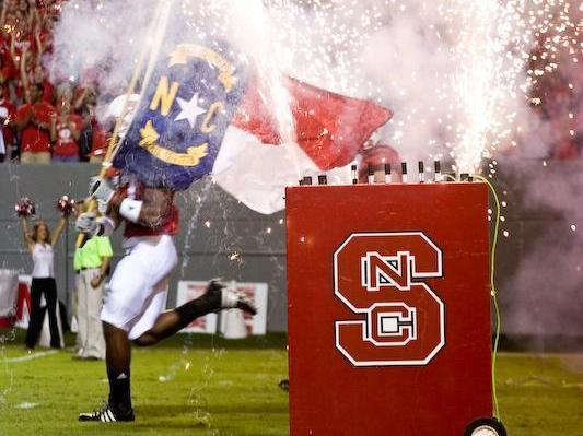 The NC State football team runs onto the field prior to their game against USF.<br/>Photographer: Ben McKeown