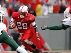 N.C. State's Jamelle Eugene rushes away from Miami defenders on November 29, 2008.