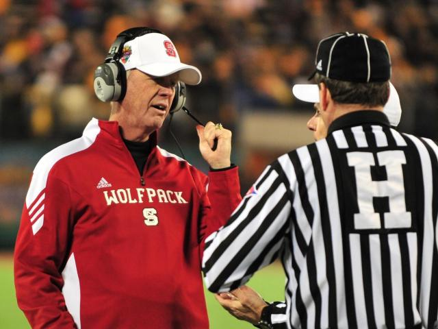 Tom O&#039;Brien has a word with referee during the North Carolina State Wolfpack vs. West Virginia Mountaineers game, Tuesday, December 28, 2010 at the Champs Sports Bowl in Orlando, FL. <br/>Photographer: Will Bratton