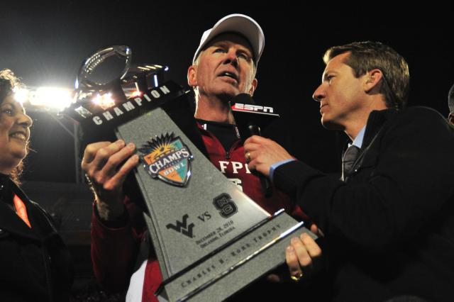 Tom O&#039;Brien accepts the Champs Sports Bowl trophy following the North Carolina State Wolfpack vs. West Virginia Mountaineers game, Tuesday, December 28, 2010 at the Champs Sports Bowl in Orlando, FL. <br/>Photographer: Will Bratton