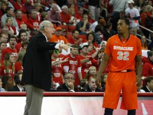 Coach Jim Boeheim instructs Kris Joseph (32) during the Syracuse vs. NC State game on December 17, 2011 in Raleigh, North Carolina.
