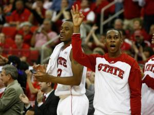 Lorenzo Brown and Jaqawn Raymond celebrate Johnson's three during the Miami vs. NC State game on February 29, 2012 in Raleigh, North Carolina.