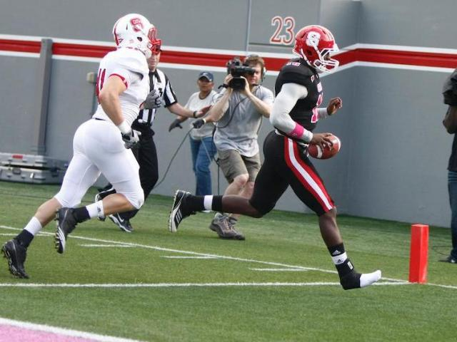 Manny Stocker (16) only needs one shoe to find the endzone during the NC State Kay Yow 2012 Spring Football Game in Raleigh, NC on April 21, 2012. <br/>Photographer: Jerome  Carpenter
