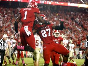 David Amerson (1) and Earl Wolff (27) celebrate a defensive stand during the Florida State vs. NC State game on October 6, 2012 in Raleigh, North Carolina.