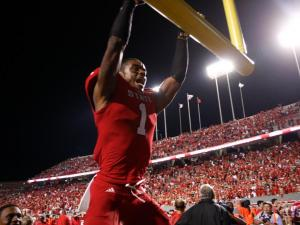 David Amerson (1) grabs the upright to celebrate victory over Florida State on October 6, 2012 in Raleigh, North Carolina.