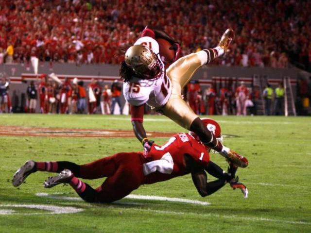 David Amerson (1) upends Greg Dent (15) during the Florida State vs. NC State game on October 6, 2012 in Raleigh, North Carolina.<br/>Photographer: Jerome Carpenter