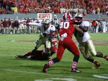 Chris Thompson (4) tries to break a tackle during the Florida State vs. NC State game on October 6, 2012 in Raleigh, North Carolina.