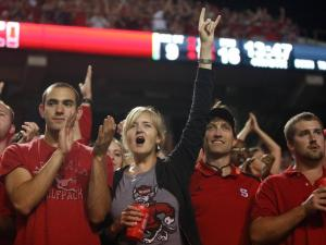 Fans cheer on the Pack's comeback during the Florida State vs. NC State game on October 6, 2012 in Raleigh, North Carolina.