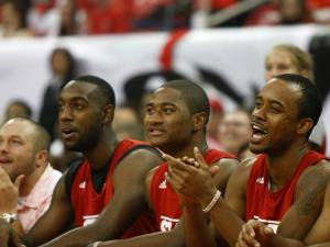 Teammates cheer on Scott Wood's three point performance during Primetime with the Pack on October 12, 2012 in Raleigh, North Carolina.