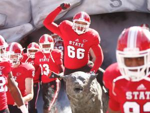 Quincey McKinney rides the wolf before the start of the Virginia vs. NC State game on November 3, 2012 in Raleigh, North Carolina.