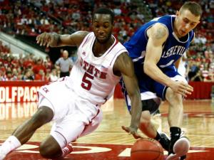 C.J. Leslie (5) and Keith Hornsby (4) race for a loose ball during the UNC Asheville vs. NC State game on November 23, 2012 in Raleigh, North Carolina.