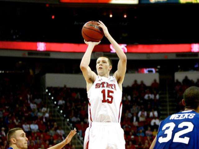 Scott Wood (15) elevates to drain a three pointer during the UNC Asheville vs. NC State game on November 23, 2012 in Raleigh, North Carolina. <br/>Photographer: Jerome Carpenter