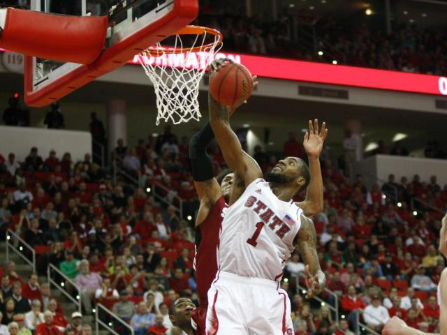 Richard Howell (1) grabs a rebound during the Stanford vs. NC State game on December 18, 2012 in Raleigh, North Carolina.<br/>Photographer: Jerome Carpenter
