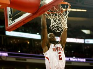 Lorenzo Brown (2) dunks on a breakaway during the Stanford vs. NC State game on December 18, 2012 in Raleigh, North Carolina.