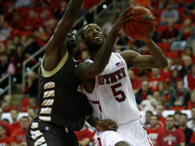 C.J. Leslie (5) attacks the rim from the baseline during the St. Bonaventure vs. NC State game on December 22, 2012 in Raleigh, North Carolina. <br/>Photographer: Jerome Carpenter