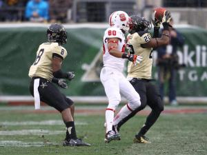 Vanderbilt safety Eric Samuels (22) grabs an interception at the Music City Bowl December 31, 2012. (Photo by Jack Tarr)
