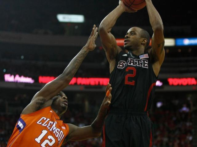 Lorenzo Brown (2) creates space against Rod Hall (12) to get off a jump shot during the Clemson vs. NC State game on January 20, 2013 in Raleigh, North Carolina. <br/>Photographer: Jerome Carpenter