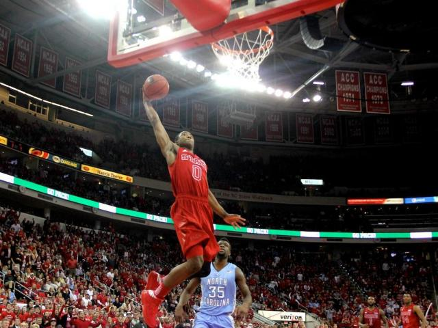 Rodney Purvis (0) flies in for a dunk during the UNC vs. NC State game on January 26, 2013 in Raleigh, North Carolina.<br/>Photographer: Jerome Carpenter