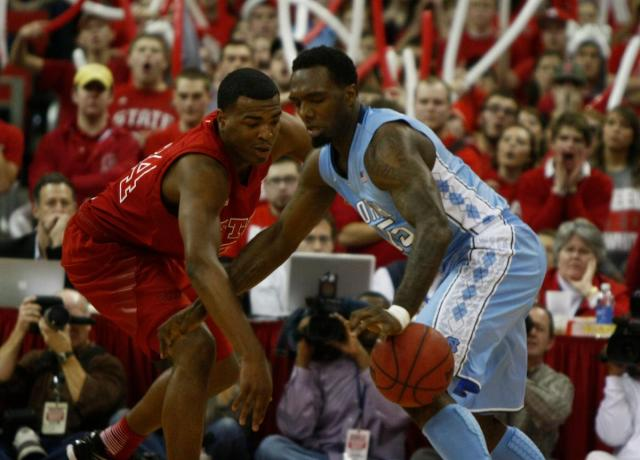 T.J. Warren (24) knocks the ball from P.J. Hairston (15) during the UNC vs. NC State game on January 26, 2013 in Raleigh, North Carolina.<br/>Photographer: Jerome Carpenter