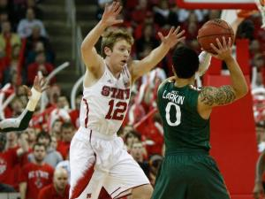 Tyler Lewis (12) defends against Shane Larkin (0) during the Miami vs. NC State game on February 2, 2013 in Raleigh, North Carolina.
