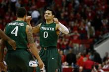 Shane Larkin (0) celebrates a win over NC State on February 2, 2013 in Raleigh, North Carolina.