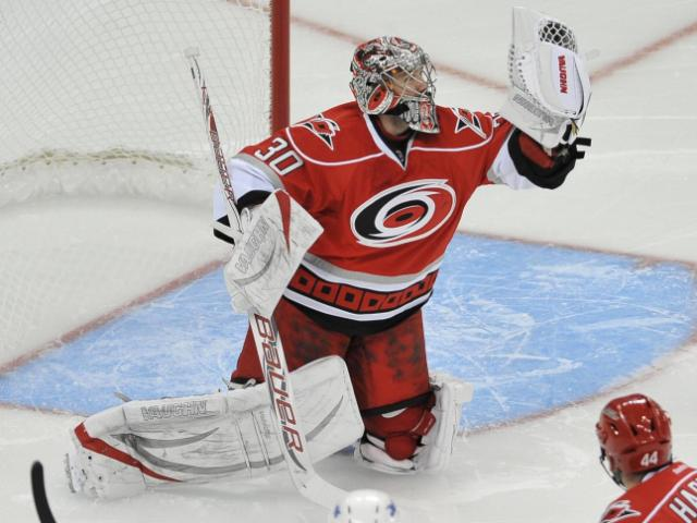 Carolina Hurricanes goalie Cam Ward (30) makes a nice save during the Hurricanes vs Winnipeg Jets game on February 21, 2013  in Raleigh North Carolina. (Photos By Anthony Barham)