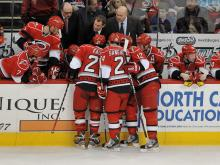 The Tampa Bay Lightning scored four goals in the third period to beat the Hurricanes 5-2 Saturday at PNC Arena and claim the top spot from Carolina in the Southeast Division.