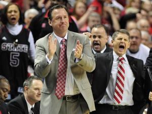 NC State head coach Mark Gottfried and associate head coach Bobby Lutz (right) react to a call during first round action of the 2013 ACC Men's Basketball Conference Tournament between NC State and Virginia Tech at the Greensboro Coliseum on March 14, 2013 in Greensboro, NC.