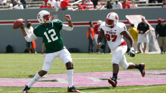 Jacoby Brissett (12) drops back to throw a deep ball into the end zone during the NC State Spring Game on April 20, 2013 in Raleigh, NC.