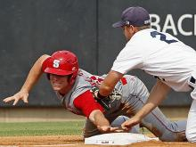 North Carolina State's Brett Williams, left, gets caught trying to steal third by Rice's Shane Hoelscher (2) during the second inning of an NCAA college baseball tournament super regional game, Sunday, June 9, 2013, in Raleigh, N.C. (AP Photo/Karl B DeBlaker)