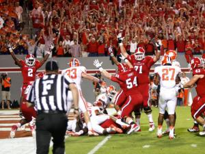 State celebrates a Thornton touchdown during the Clemson vs. NC State game on September 19, 2013 in Raleigh, North Carolina.