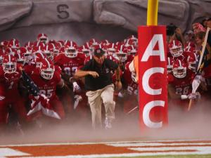 Head Coach Dave Doeren leads his team out before the Clemson vs. NC State game on September 19, 2013 in Raleigh, North Carolina.
