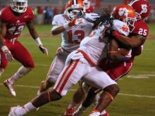 NC State's defense kept QB Tajh Boyd under pressure, but the Wolfpack lacked big plays to upset Clemson.