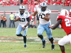 Marquise Williams (12) holds on to the ball during the UNC vs. NC State game on November 2, 2013 in Raleigh, North Carolina.