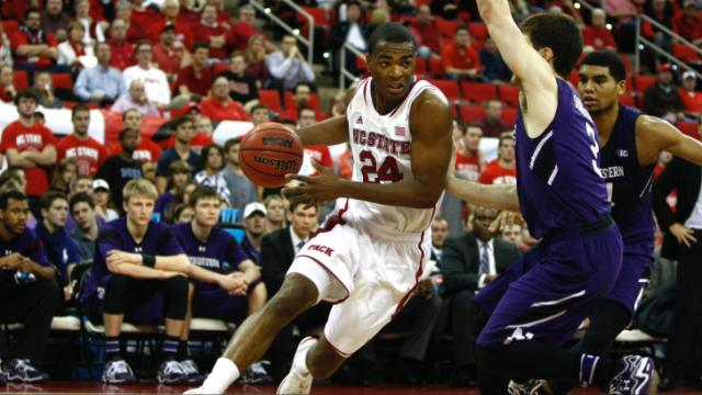 T.J. Warren (24) drives against Dave Sobolewski (3). NC State hosted Northwestern for the ACC/Big Ten Challenge on December 4, 2013 in Raleigh, North Carolina.