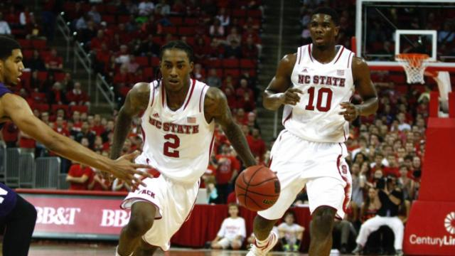 Cat Barber (2) brings the ball up court. NC State hosted Northwestern for the ACC/Big Ten Challenge on December 4, 2013 in Raleigh, North Carolina.