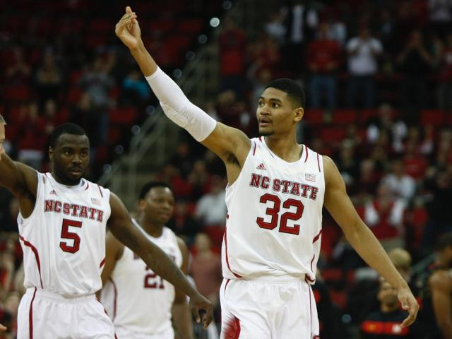 Kyle Washington (32) and Desmond Lee (5) try to excite the crowd.  NC State defeated Maryland 65-56 on January 20, 2014 at the PNC Arena in Raleigh, NC. Photo by: Jerome Carpenter