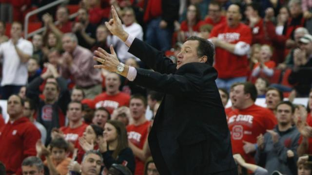 Coach Mark Gottfried calls out instructions to his team. NC State defeated Georgia Tech 80-78 on January 26, 2014 at the PNC Arena in Raleigh, NC. Photo by: Jerome Carpenter