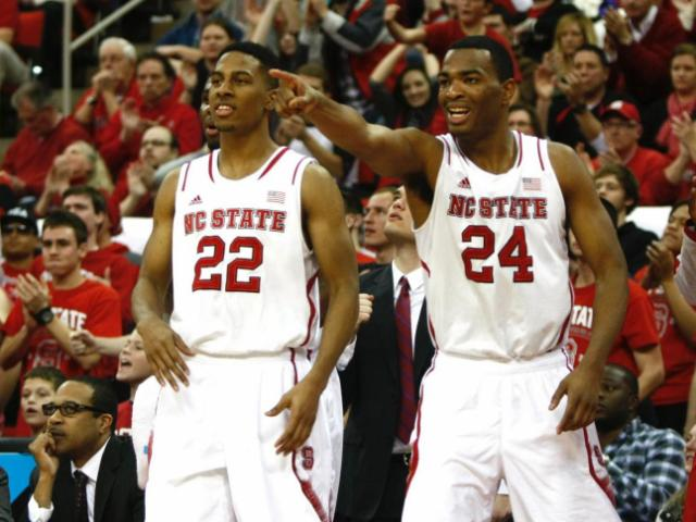T.J. Warren (24) and Ralston Turner (22) cheer on their teammates. NC State defeated Florida State 74-70 on January 29, 2014 at the PNC Arena in Raleigh, NC. Photo by: Jerome Carpenter<br/>Photographer: Jerome  Carpenter
