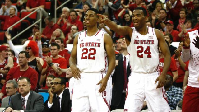 T.J. Warren (24) and Ralston Turner (22) cheer on their teammates. NC State defeated Florida State 74-70 on January 29, 2014 at the PNC Arena in Raleigh, NC. Photo by: Jerome Carpenter