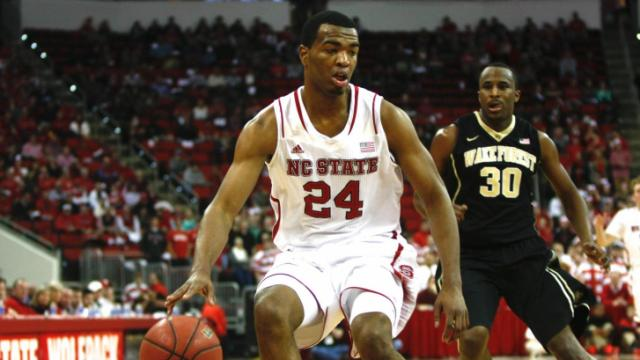 T.J. Warren (24) dribbles the ball up the court. NC State defeated Wake Forest 82-67 at the PNC Arena in Raleigh, North Carolina on February 11, 2014. Photo by: Jerome Carpenter.