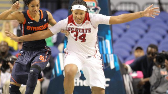 North Carolina State Wolfpack center Markeisha Gatling (34) watching the loose ball. N.C. State faces Syracuse in the Women's ACC Championship quarter final game in Greensboro N.C. After a close first half, N.C. State has a strong second half and wins by a score of 63 to 79. (Chris Baird / WRAL Contributor).