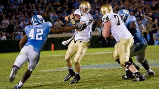 Irish quarterback Jimmy Clausen is pressured by the UNC defense in Chapel Hill during a 2008 game. Notre Dame will return to Chapl Hill in 2014 for a matchup with the Tar Heels.