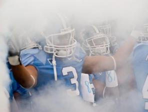 The UNC Tar Heels exit the tunnel at Keenan Stadium prior to their game against Boston College.