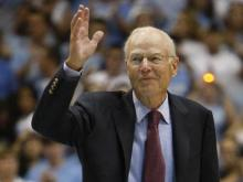 Coach Bill Guthridge waives to the crowd  during the UNC Alumni game, Friday, September 4, 2009 at the Dean Smith Center in Chapel Hill.  Photo by Todd Melet