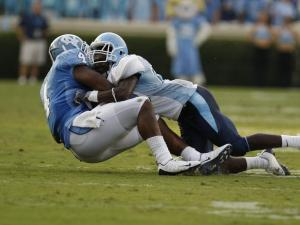 Tar Heels Bobby Rome catches a pass and is brought down in the Tar Heels season opener against Citadel at Kenan Stadium in Chapel Hill, Saturday, September 5, 2009.  Photo by Todd Melet
