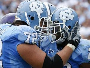 Kyle Jolly congratulates Shaun Draughn after a big run for North Carolina against East Carolina on September 19, 2009.