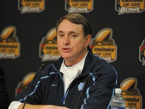 Butch Davis makes a comment during a post game interview following the Meineke Car Care Bowl (UNC vs. Pittsburgh), Saturday, December 26, 2009 at Bank of America Stadium.  (Photo by: Will Bratton)