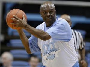 Phil Ford moves the ball around during the Celebration of the Century at UNC's Dean E. Smith Center, Friday, February 12, 2010. Photo by Todd Melet.